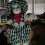 doll wearing a black and white check outfit