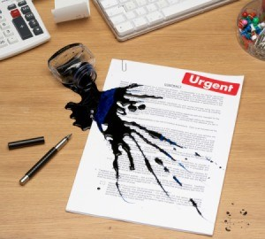 spilled ink on document
