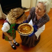 grandmother and child with pumpkin pie hot from the oven