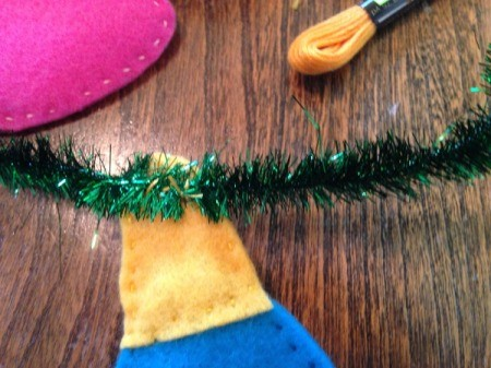 back side of bulb stitched to tinsel