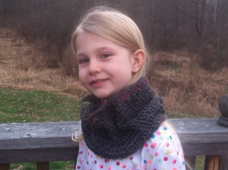 young girl wearing cowl