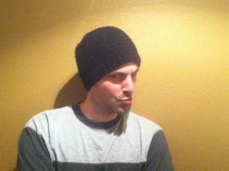 goofing around husband wearing hat
