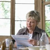 Woman looking at a bill.