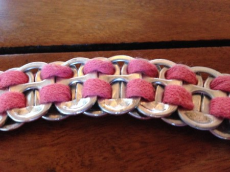 Soda Tab Bracelet closeup made from soda tabs and a pink shoelace.