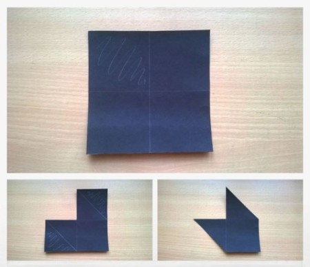 Here is paper being folded to make a corner bookmark.