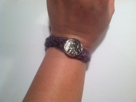 bracelet buttoned onto wrist