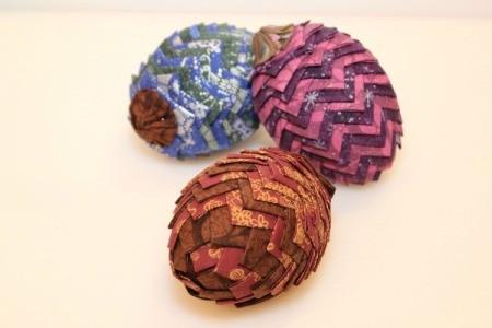 three fabric pinecone decorations