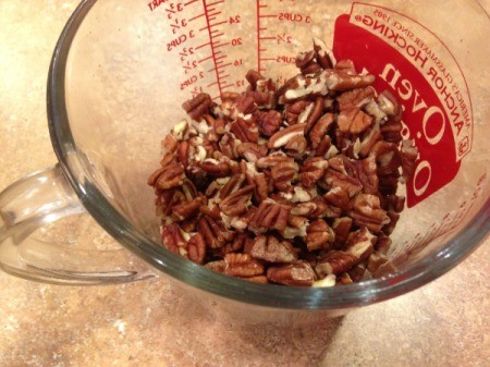 Southern Pecan Pie - broken pecans in measuring cup