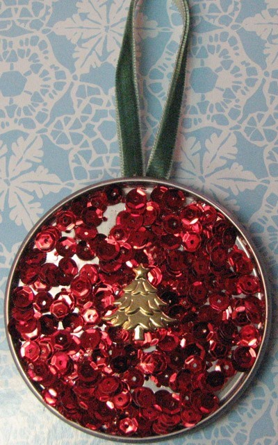 An ornament made from a juice can lid.