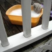 closeup of clean railing and pan of soapy water