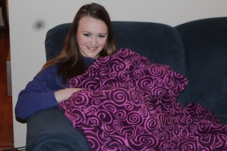 First Sewing Project: Fleece Blanket - girl on couch with blanket