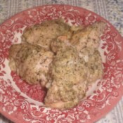 baked chicken on a red and white plate