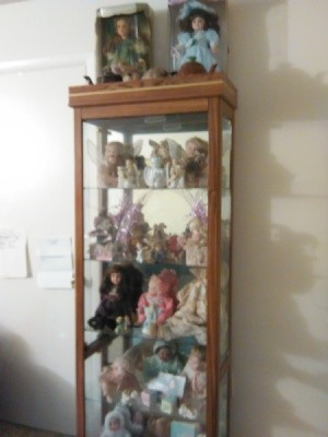 dolls in a display cabinet
