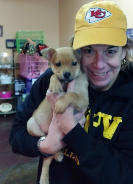 young woman holding puppy