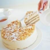 cutting a slice of almond cake