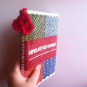 heart dangling with bookmark in book