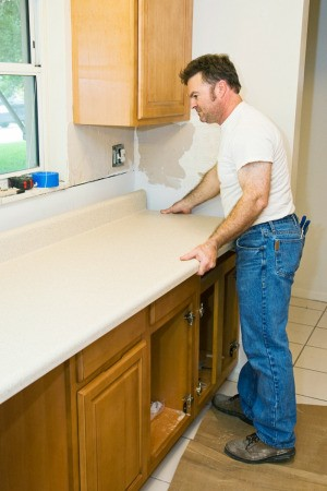 Man Repairing a Laminate Counter