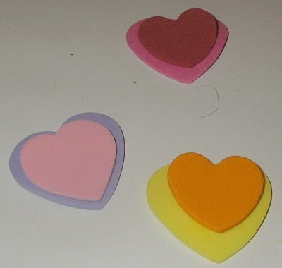 various colored paper hearts