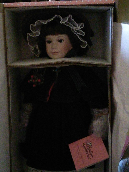 doll in box, very dark photo