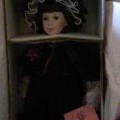 doll in box, very dark photo