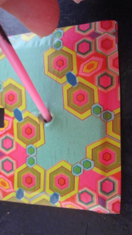 pressing paper into screw holes