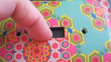 pressing paper into switch hole