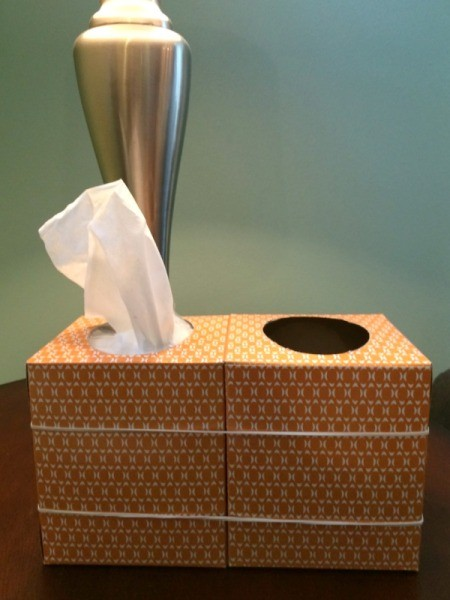 tissue and trash can on table