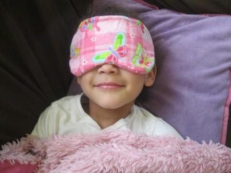 little girl wearing sleep mask