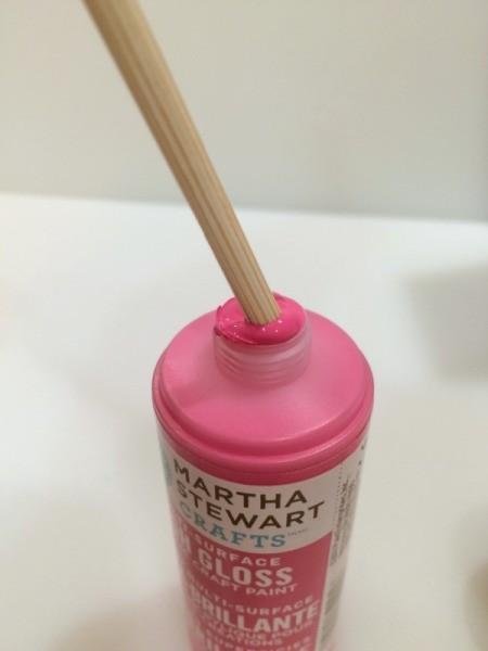 dipping skewers in paint