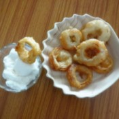Beer Battered Onion Rings  Recipe - Onion rings being served with mayo
