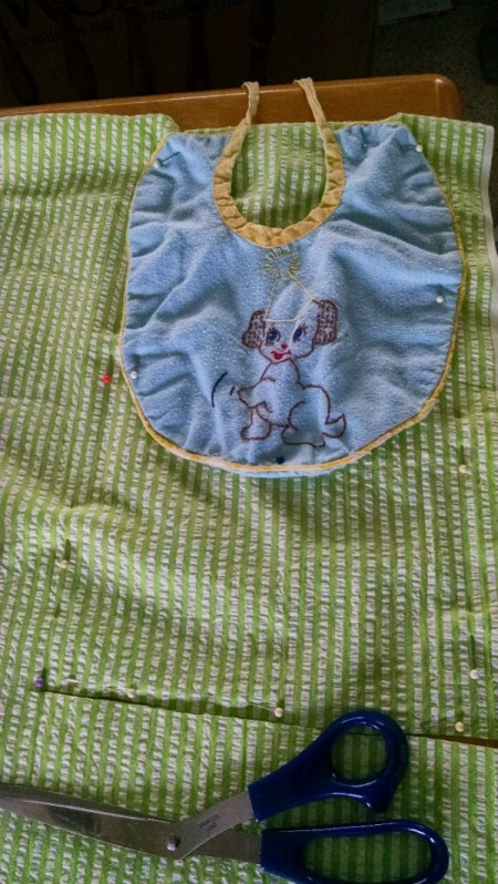 measuring for larger bib using a small baby bib