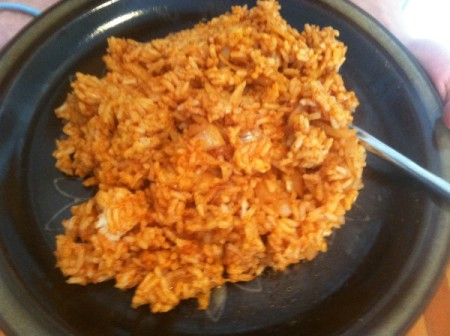 A scoop of cooked South of the Border Rice.