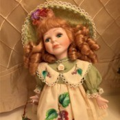 red headed doll in pinafore type dress