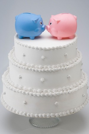 Piggy banks on top of wedding cake