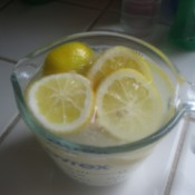 Lemon and Baking Soda for Cleaning Microwave - A measuring cup with lemons and baking soda.