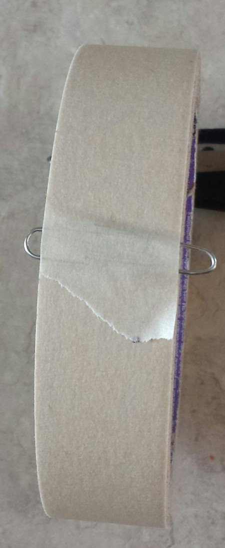 Paper clip holding tape end.