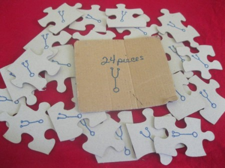 A drawing on the back of each piece in a puzzle