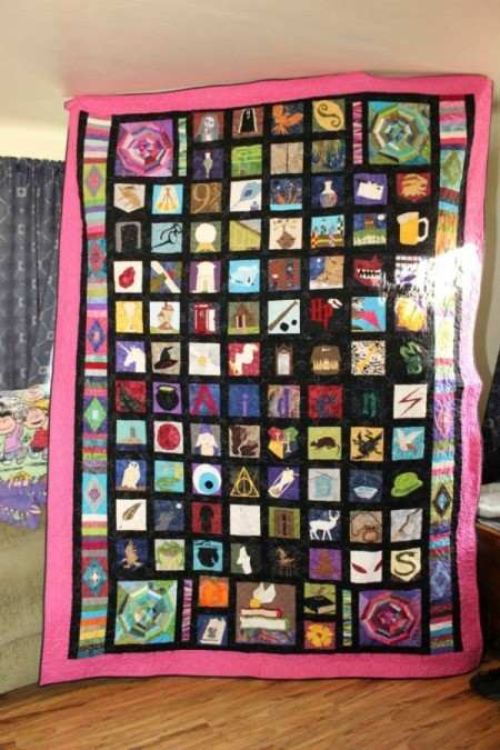 full quilt being held up