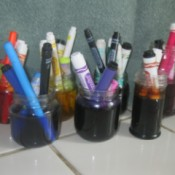 jars with markers soaking in water