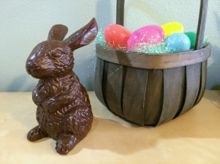 bunny sitting next to basket with plastic Easter eggs