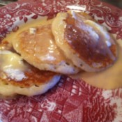 Creamy Vanilla Pancake Syrup - homemade syrup on a plate of pancakes