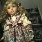 doll wearing dress with large green bow