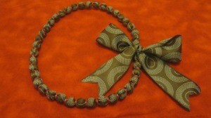 ribbon covered necklace with large bow