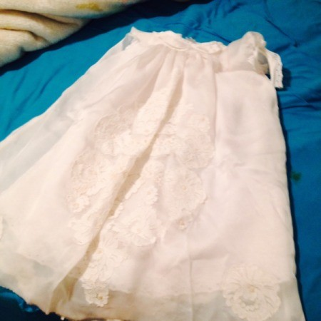 A christening gown made from an old wedding dress.