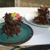 Homemade candy trees with nests and jelly bean eggs.