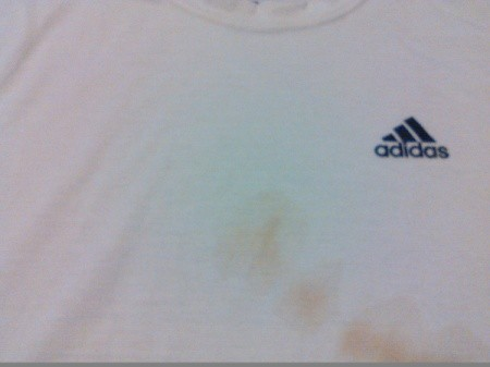 white shirt with stains and a colored logo