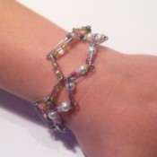 Safety pin bracelet being worn on wrist.