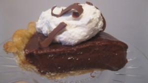 A piece of chocolate cream pie.