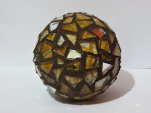 A glass ball with a funky pattern.
