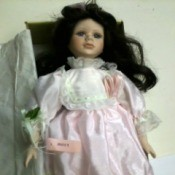 doll with dark hair and wearing pink dress